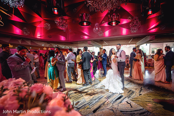 Newlyweds, friends and family on the dance floor