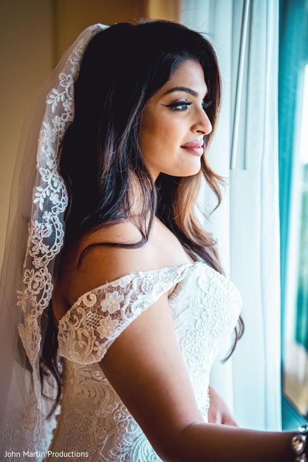 Maharani wearing a white wedding dress.