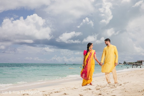 Maharani and groom walking on the beach