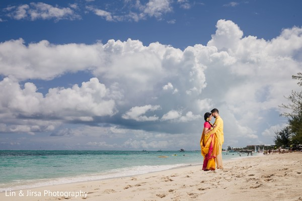 Maharani and groom holding each other at the beach