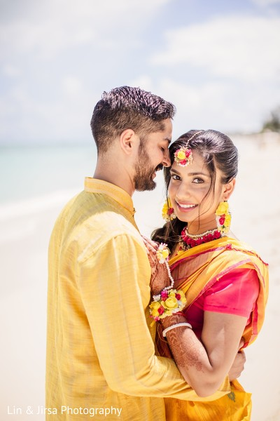 Maharani and groom sharing a moment in front of the ocean