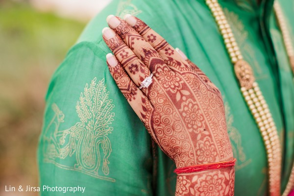 Maharani's hand on the Indian groom shoulder