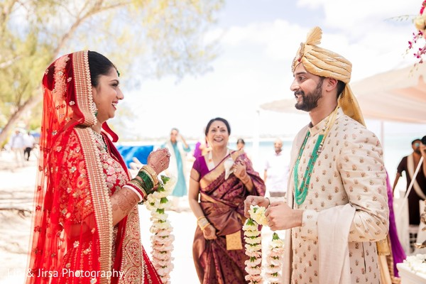 Indian couple about to exchange garlands.
