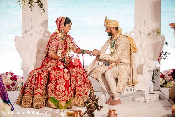 Indian groom putting ring on his Maharani.
