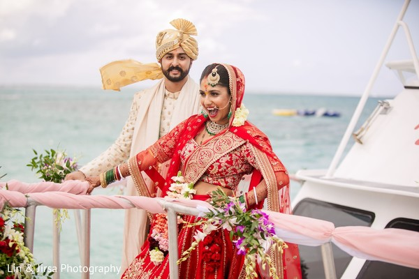 Indian bride and her groom enjoying a boat ride.