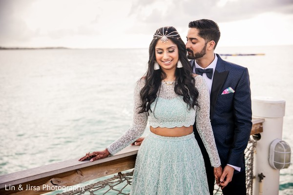 Indian couple in photo session by the shore.