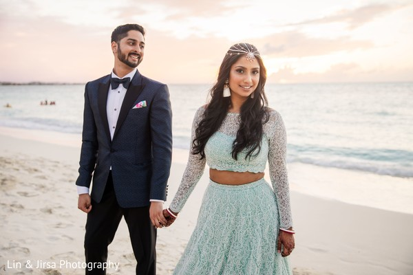 Indian bride gown and Indian groom in suit by the beach.