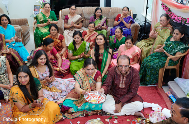 Indian family sitting together for pre wedding ritual.