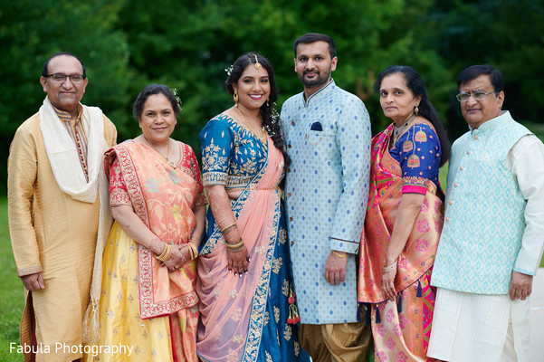 Indian couple with their parents in Sangeet picture.