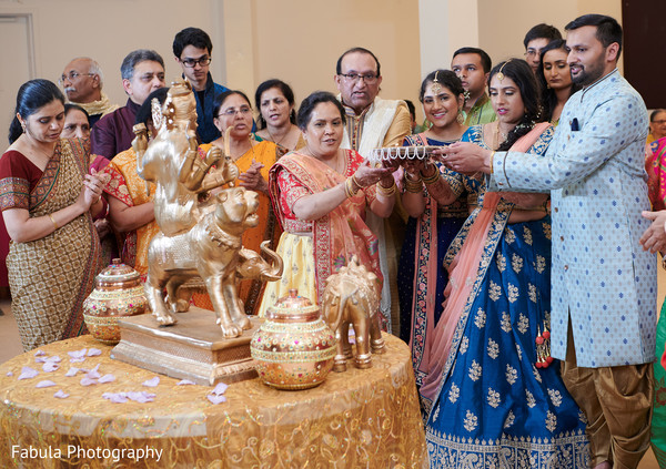 Maharani and Indian relatives giving offerings to their Indian deity.