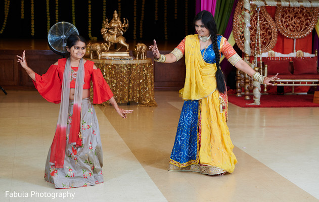Indian bridesmaids dancing in reception party.