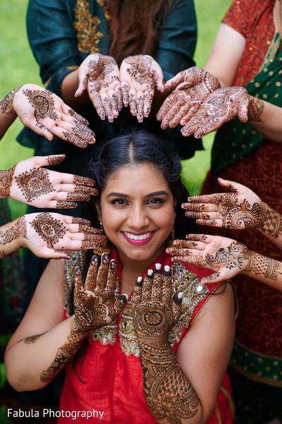 Maharani and her Indian bridesmaids showing their mehndi art.
