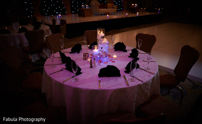 Candles decorating table in hindu reception party.