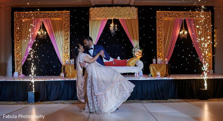 Indian bride dancing with her Indian groom.