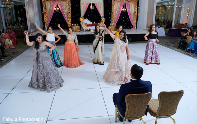 Maharani and bridesmaids performing for Indian groom.
