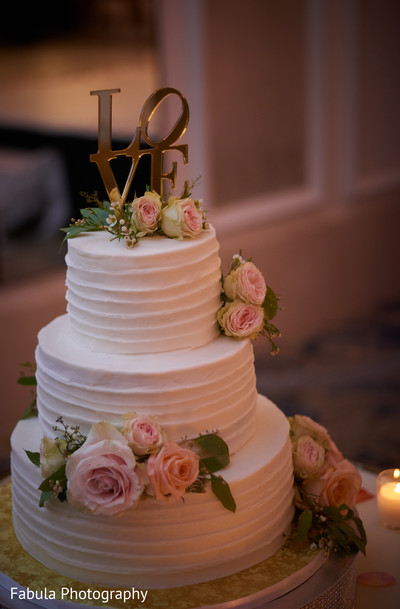 Indian wedding cake decorated with roses.