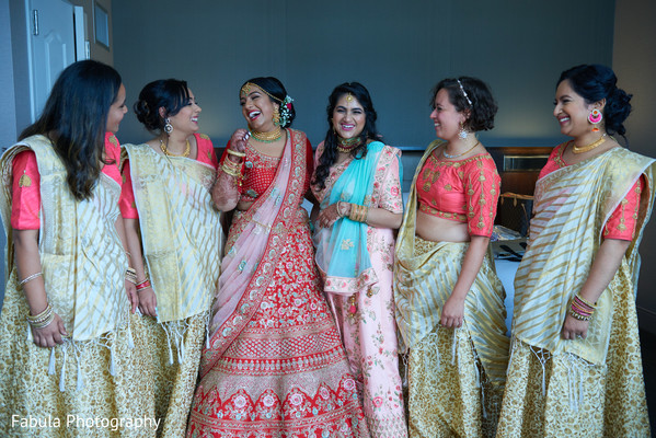 Indian bride having a good time with her Indian bridesmaids.