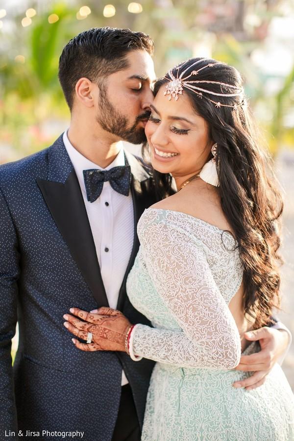 Indian groom kissing his Maharani in photo shoot.