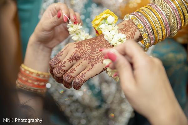 Maharani getting her flowers brazalete for the haldi rituals.