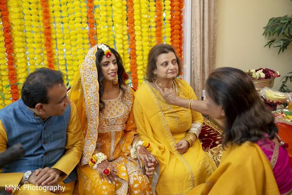 Indian bridal relatives during the haldi ritual.