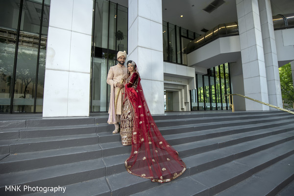 Indian bride and groom posing for photo shoot.