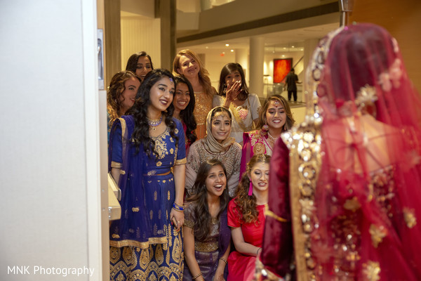 Indian bridesmaids admiring maharani.