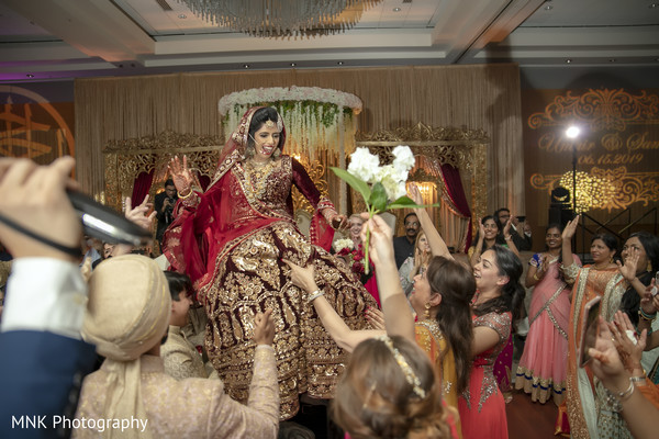 Indian bride at traditional wedding celebration.