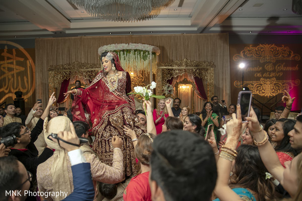 Indian bride lifted by groomsmen capture.