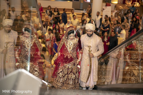 Indian couple leaving from wedding ceremony.