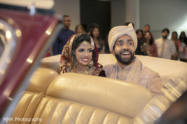 Indian couple about to leave their ceremony.
