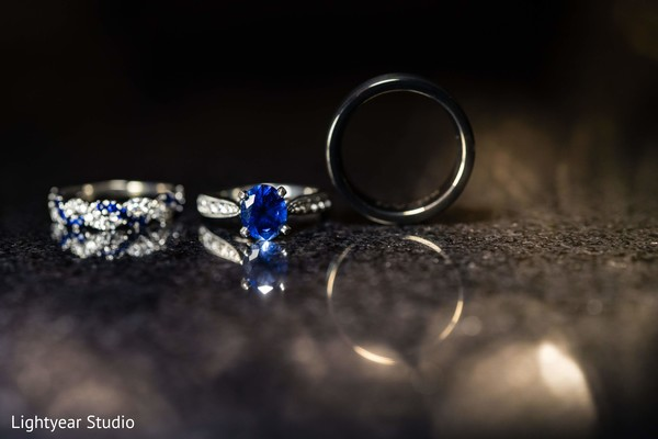 Indian chinese white gold and blue diamond wedding rings.