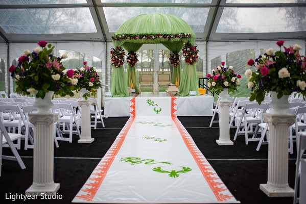 Indian chinese green mandap and white wedding ceremony aisle.