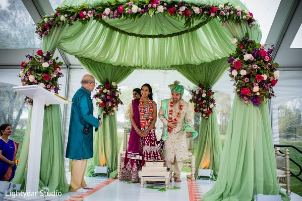 Indian bride and chinese groom at their ceremony rituals.