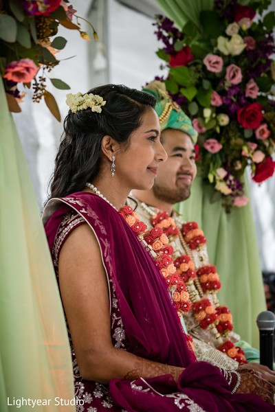 Indian couple exchanging the artificial flower garlands.