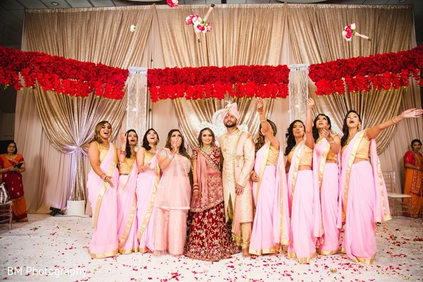 Indian couple with bridesmaids in wedding attires.
