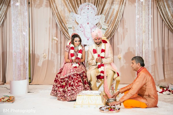 Indian bride and Indian groom praying during ceremony.