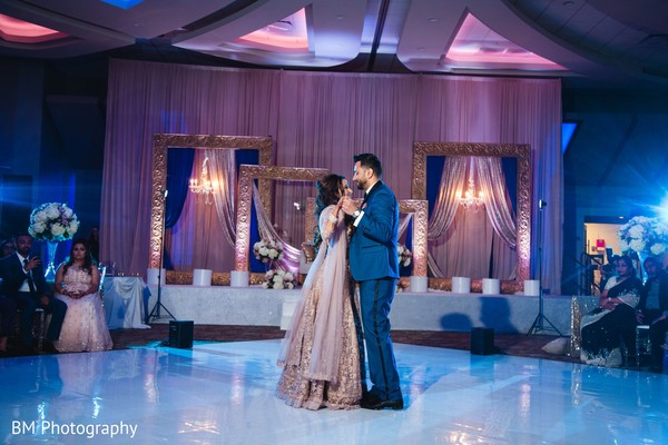 Indian groom and his Maharani dancing at the reception