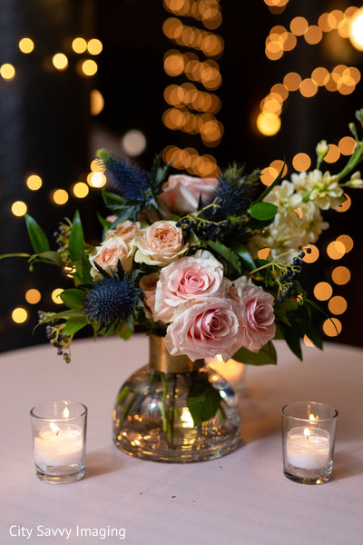 Indian wedding table pink, peach and zabelii Blue flowers centerpiece.