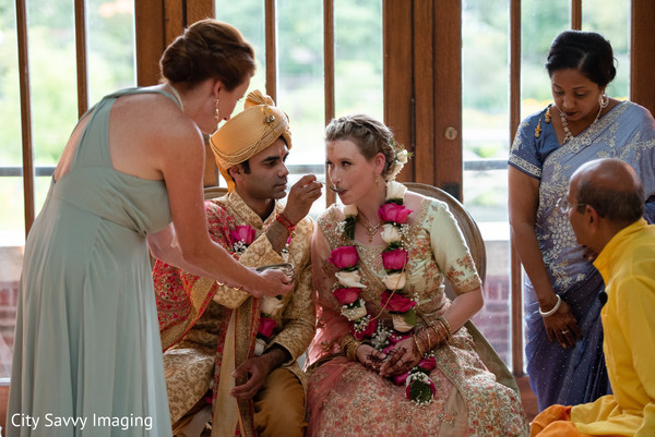 Indian groom sharing food with bride ritual.
