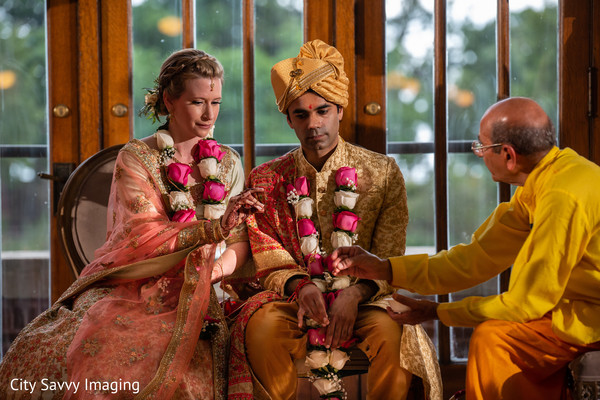 Indian couple at their ceremony rituals capture.