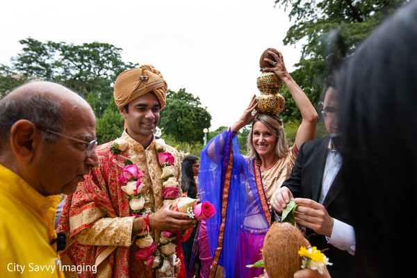 Indian groom with relatives during the coconut pre-wedding rituals.