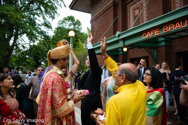 Indian relatives blessing groom.