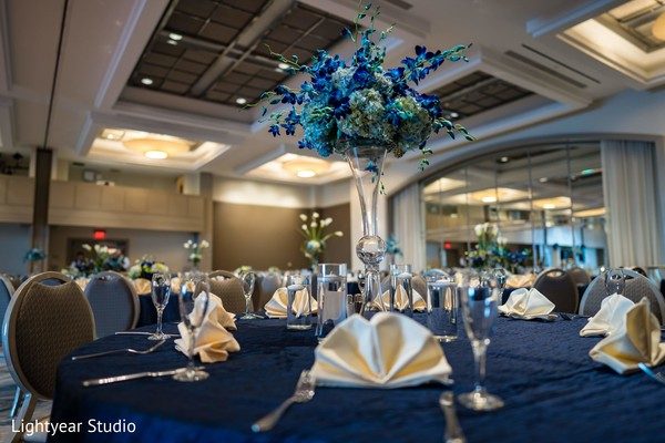 Blue color decorations for Indian chinese wedding tables.