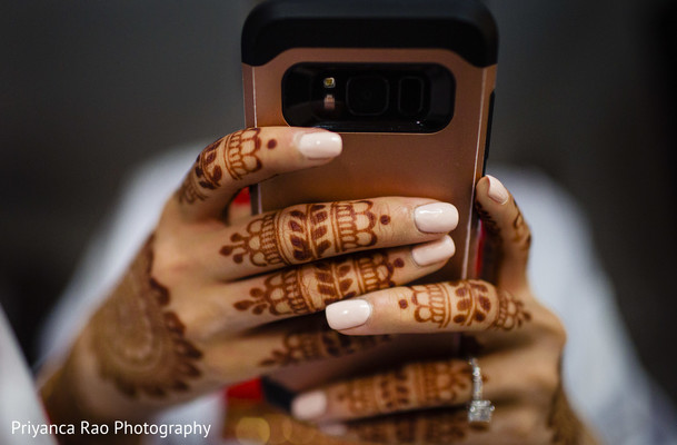 A mirror picture of the Maharani's henna stained hands.