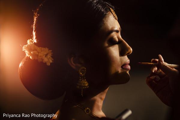 Maharani getting her make up done
