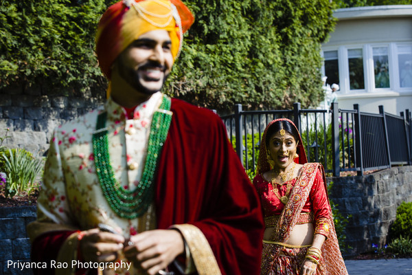 Indian groom being followed by his Maharani