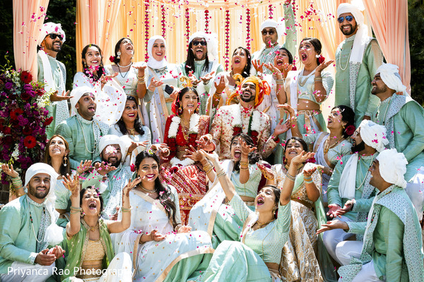 Indian bride and Indian groom with their bridesmaids and groomsmen.
