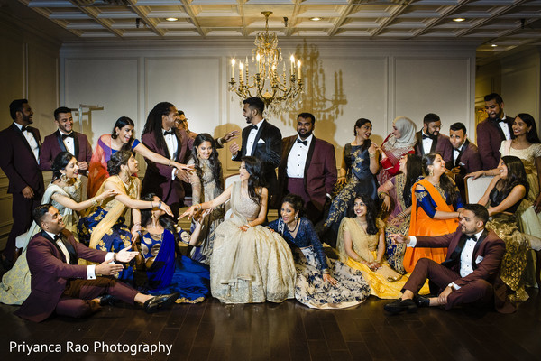 Maharani and Indian groom with the bridesmaids and groomsmen.