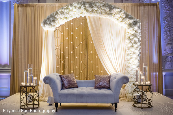 Sofa decorated for Indian couple.