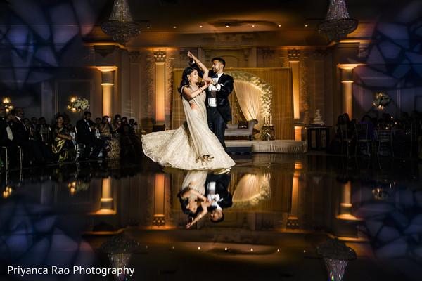 Maharani and Raja in reception wear dancing.